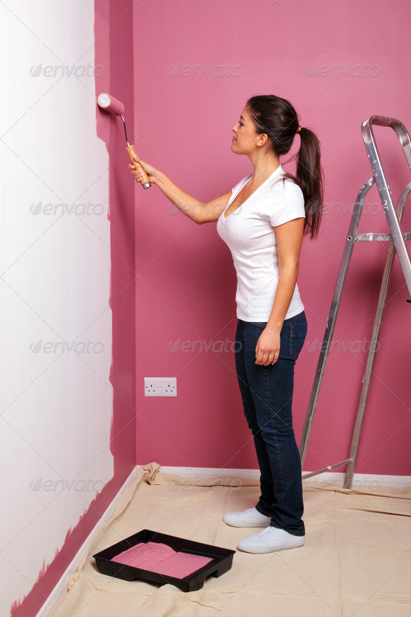 Young woman decorating - Stock Photo - Images