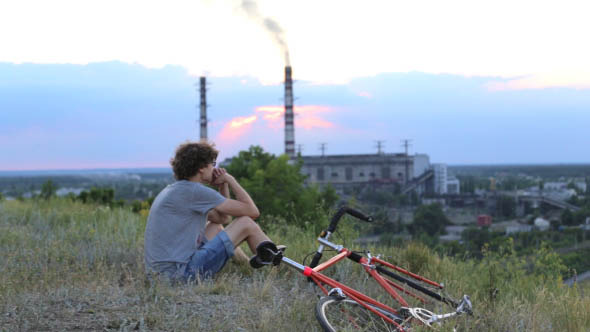 Cyclist on the Background of the Plant