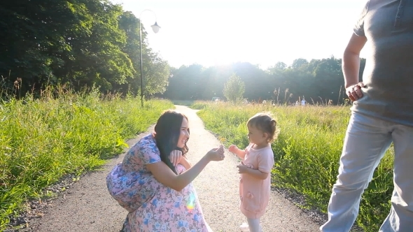 Beautiful Mother And Baby Outdoors Nature