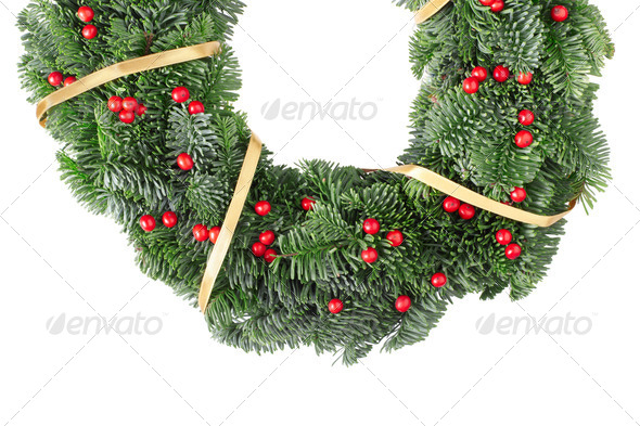 Christmas wreath with golden ribbon and red berries on white - Stock Photo - Images