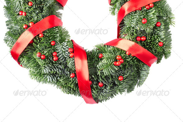 Christmas pine wreath with red satin ribbon and berries on white - Stock Photo - Images