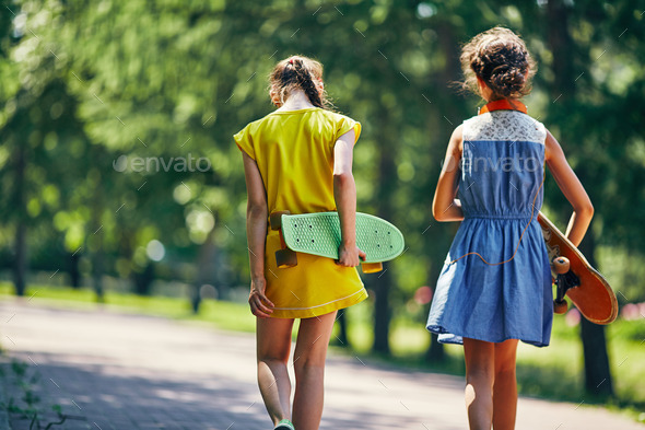 Girls with skateboards - Stock Photo - Images