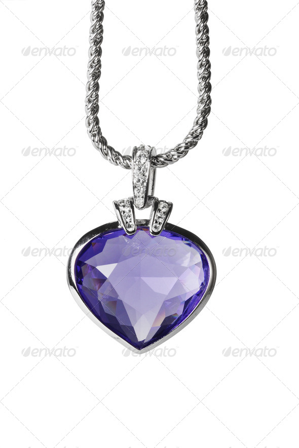 Silver pendant and blue heart shaped gemstone - Stock Photo - Images
