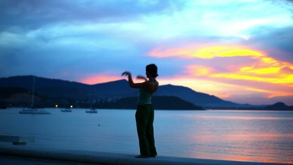Young Woman Doing Yoga Bridge Sunset Silhouette