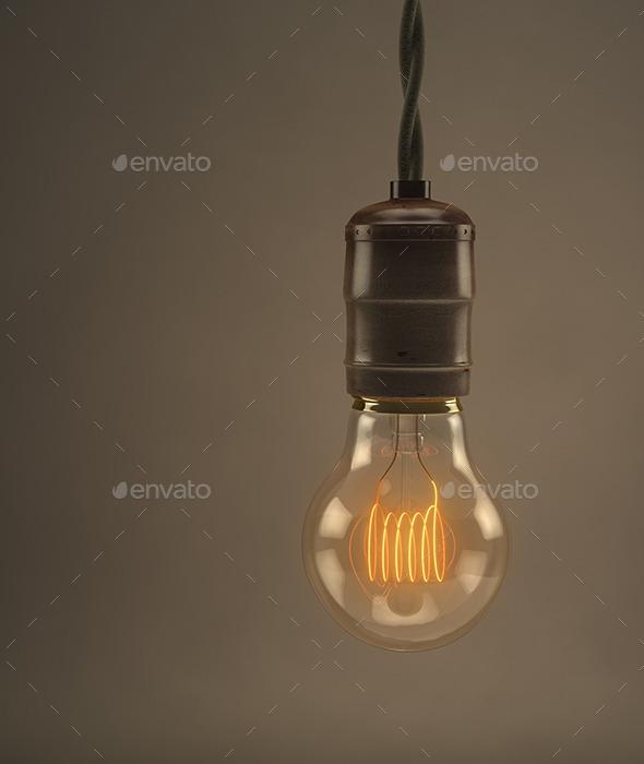 Vintage hanging light bulb over dark background - 3D Backgrounds