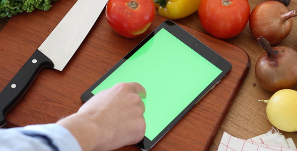 Using a Tablet at Kitchen Greenscreen