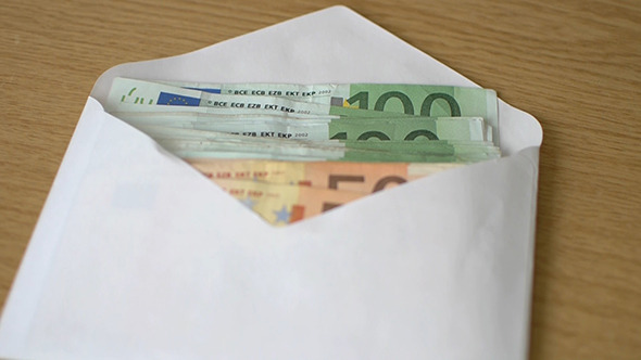 Hand Moves Envelope With Euro Money On The Table