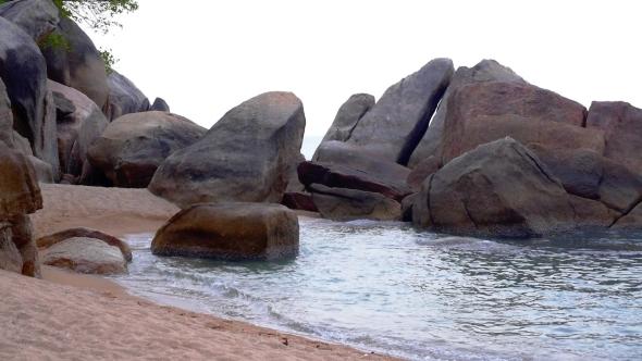 Foamy Waves Splashing Against The Rocks Serene