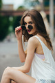 beautiful girl in sunglasses sitting - PhotoDune Item for Sale