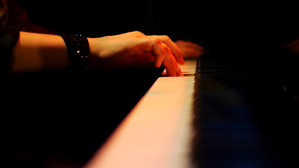 Woman Pianist Hands Plays The Piano