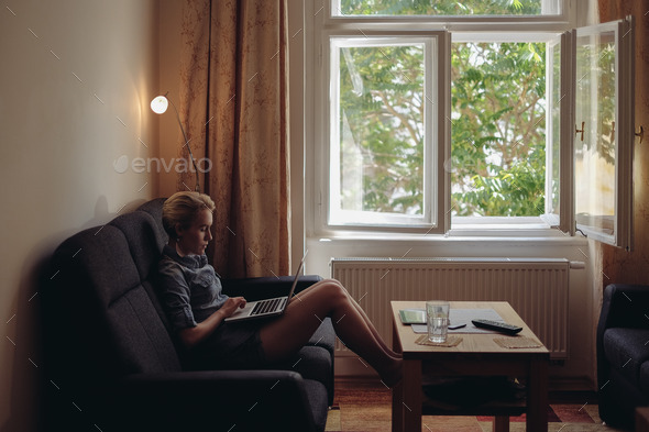 with laptop in living room - Stock Photo - Images