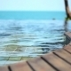 Woman Swimming In Pool And Ocean On The Background - VideoHive Item for Sale