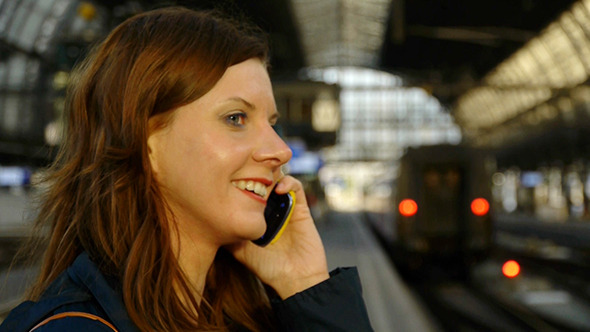 Woman Talking On Cellphone On Train Station