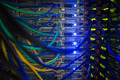 Interior of server with wires blue close up in data center - PhotoDune Item for Sale