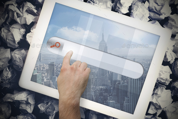 Hands touching search bar on tablet screen on crumpled up paper - Stock Photo - Images