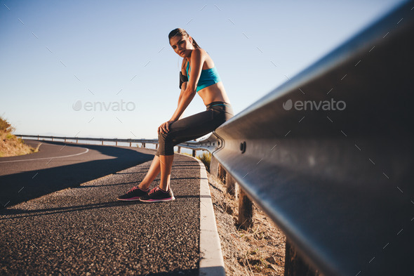 Woman relaxing after a outdoor training - Stock Photo - Images