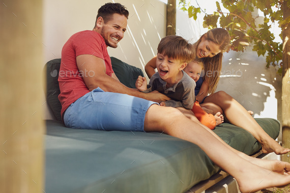 Happy family having fun together in the backyard - Stock Photo - Images