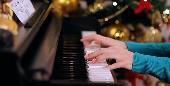 Girl Playing Piano near Christmas Tree 3