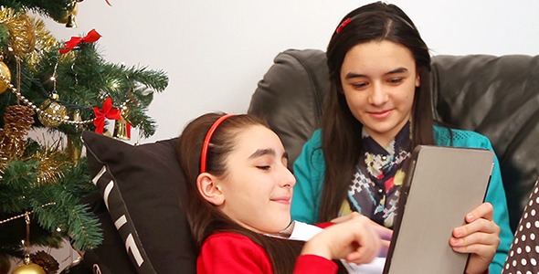 Girls with Digital Tablet near Christmas Tree 2