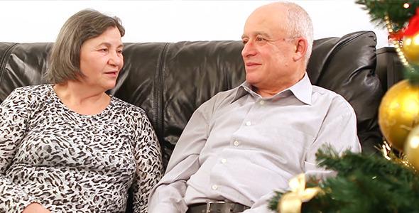 Elderly Couple Talking near Christmas Tree