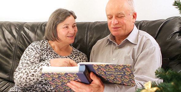 Senior Couple with Photo Album on Christmas 2