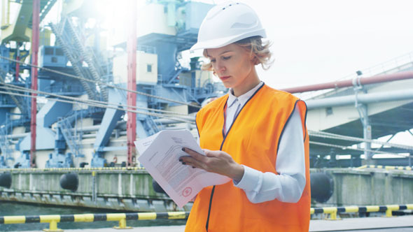 woman in hard hat in industrial environment by gorodenkoffs videohive