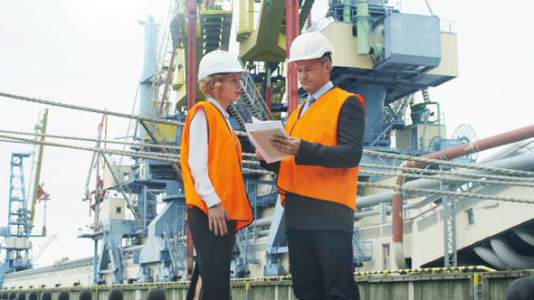 People Using Tablet PC in Industrial Environment