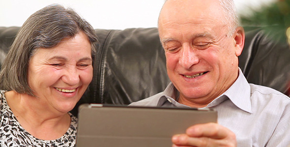 Senior Couple Using Digital Tablet at Christmas 2