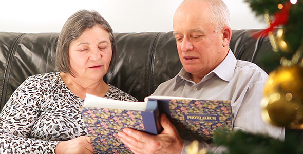 Senior Couple with Photo Album on Christmas 1