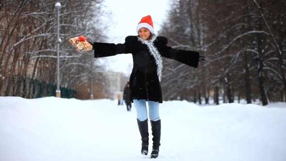 Smiling Woman With Small Gift During The Snowing