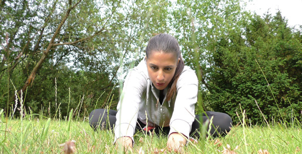 Young Woman Training on Grass in Nature 2