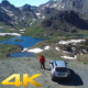 Aerial Flying Car and Man on the Mountain Peak - VideoHive Item for Sale