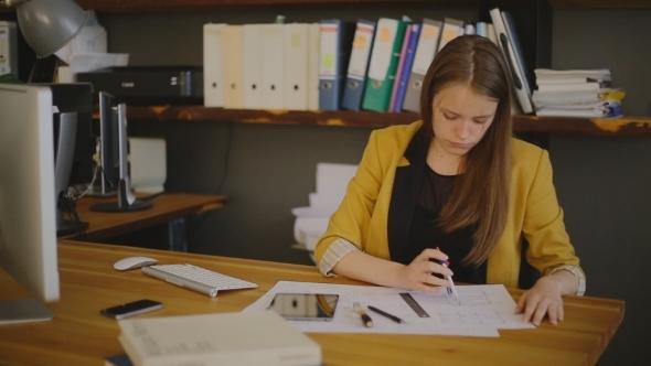 Business Woman Architect Drawing Checks