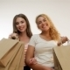 Happy Girls With Paperbags After Shopping - VideoHive Item for Sale