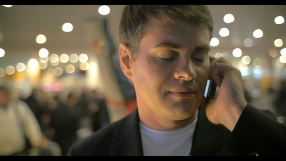 Businessman Having a Phone Talk At The Airport