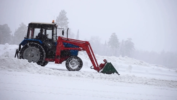 Automated Snow Plows Are Clearing a Road During a