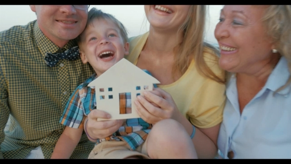 Real Estate Concept With Happy Family