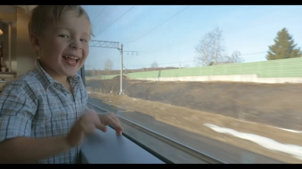 Boy Waving Hand Out Of The Train Window