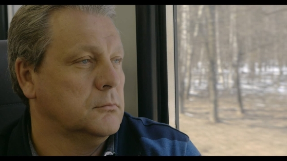 Man Enjoying Outside Scenery From Train Window