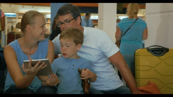 Parents And Child Using Digital Tablet