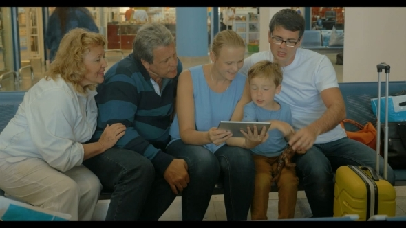 Big Family With Tablet In Waiting Room