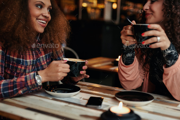 Young friends in a coffee shop - Stock Photo - Images