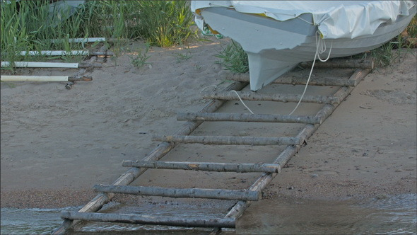 A Boat on the Ladder on the Sand