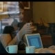 Young People With Smart Phone And Laptop In Cafe - VideoHive Item for Sale