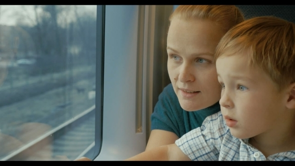 Mother And Son Looking Out Train Window