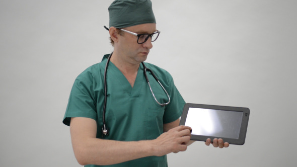Doctor Showing Detail on Tablet