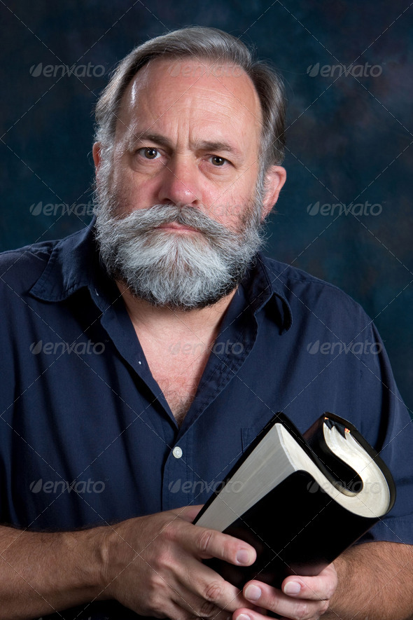 Preacher Holding Rolled Bible - Stock Photo - Images