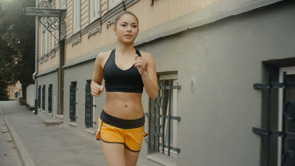Girl is Running at Morning in Residential Area