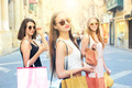 Three girls doing shopping in the city