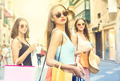Three girls doing shopping in the streets
